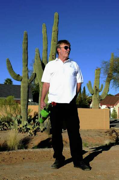 TUCSON, AZ - JANUARY 14:   Dennis Trump stands across the street from St. Elizabeth Ann Seton church