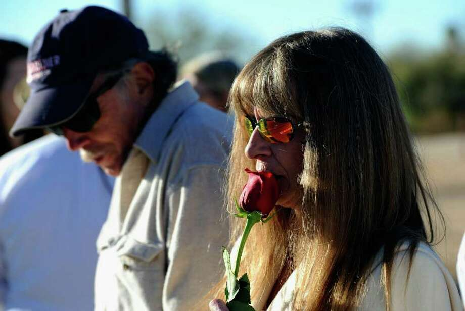 TUCSON, AZ - JANUARY 14:  Mary Koon and her husband Marty line the street to St. Elizabeth Ann Seton church for the  funeral service of US District Court Judge John Roll on January 14, 2011 in Tucson, Arizona. Heavy security surrounds the funeral of Judge Roll, who was shot during the January 8, shooting rampage of Jared Lee Loughner at a political event in Tucson, Arizona  (Photo by Kevork Djansezian/Getty Images) Photo: Kevork Djansezian