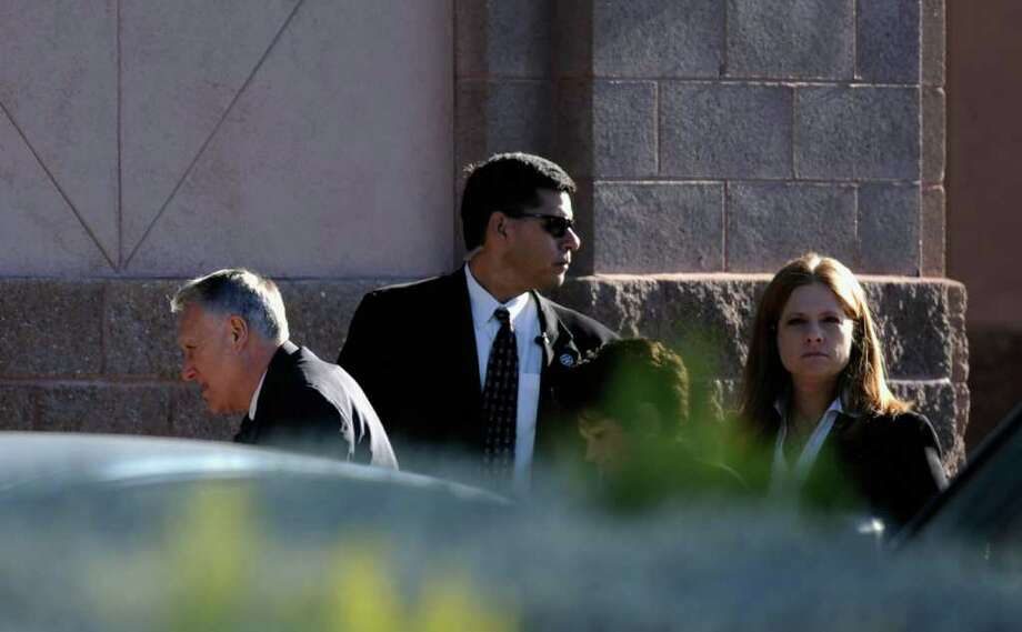 TUCSON, AZ - JANUARY 14:  Sen. Jon Kyl (R-AZ) (L) arrives to the funeral service for US District Court Judge John Roll at St. Elizabeth Ann Seton church on January 14, 2011 in Tucson, Arizona. Heavy security surrounds the funeral of Judge Roll, who was shot during the January 8, shooting rampage of Jared Lee Loughner at a political event in Tucson, Arizona  (Photo by Kevork Djansezian/Getty Images) Photo: Kevork Djansezian