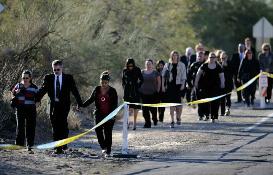 TUCSON, AZ - JANUARY 14:  Mourners arrive at the funeral service of US District Court Judge John Roll at St. Elizabeth Ann Seton church January 14, 2011 in Tucson, Arizona. Heavy security surrounds the funeral of Judge Roll, who was shot during the January 8, shooting rampage of Jared Lee Loughner at a political event in Tucson, Arizona  (Photo by Kevork Djansezian/Getty Images) Photo: Kevork Djansezian