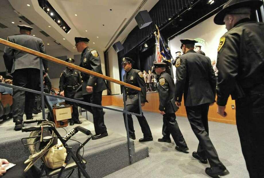 Zone Five Regional Law Enforcement Training Academy graduates walk to their seats at the beginning of a graduation ceremony at Schenectady Community College in Schenectady, NY on January 14, 2011. (Lori Van Buren / Times Union) Photo: Lori Van Buren