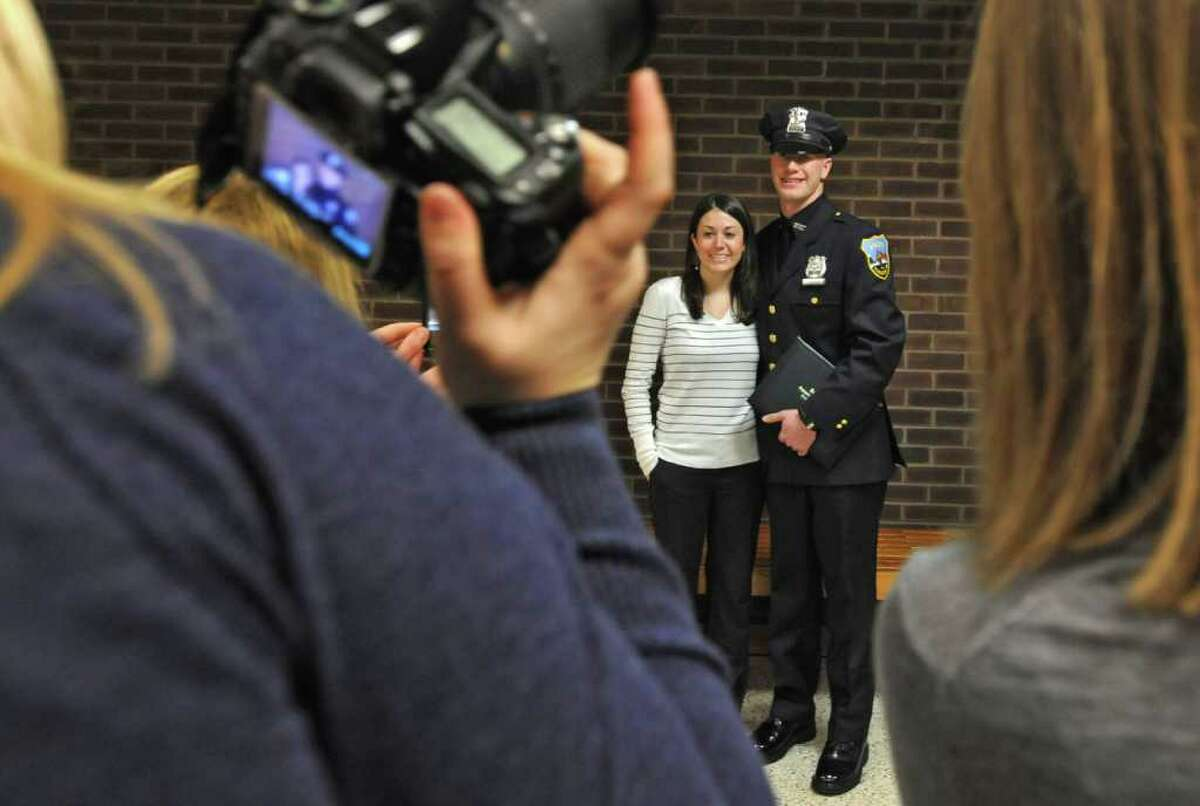 Zone Five Regional Law Enforcement Training Academy graduate Officer James Sokolowski of Rotterdam gets his photo taken with his girlfriend Kara Gillivan of Colonie after a graduation ceremony at Schenectady Community College in Schenectady, NY on January 14, 2011. Officer Sokolowski is on the Schenectady Police Department. (Lori Van Buren / Times Union)