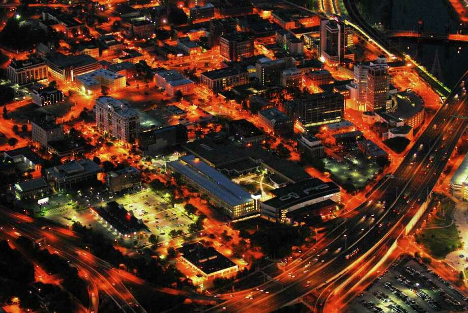 """""""City Under Lights,"""" an exhibition of 34 aerial photographs by Morgan Kaolian, runs Jan. 19-Feb. 19 at City Lights Gallery in downtown Bridgeport. The exhibit features  photos of Bridgeport taken this past summer by Kaolian, a veteran pilot, at dusk or at night. A reception, open to the public, takes place Jan. 21 from 5:30 to 8 p.m. at the gallery. Photo: CONTRIBUTED PHOTO"""