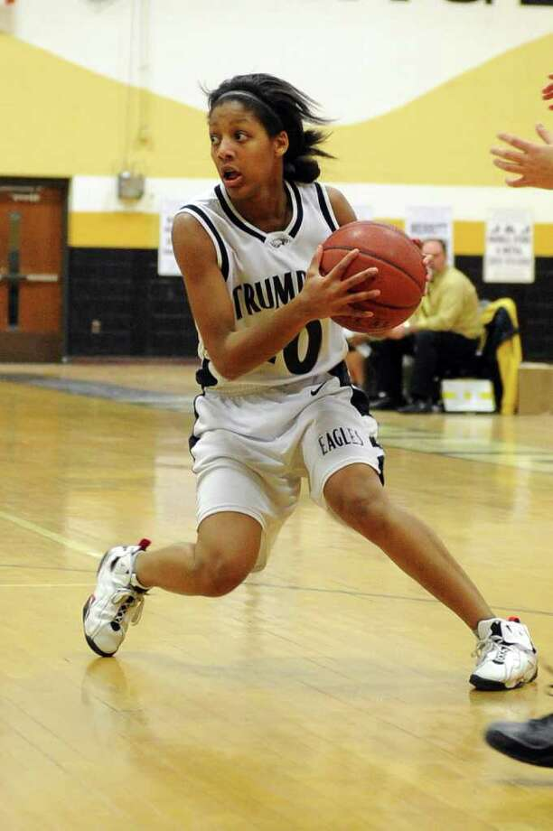 Trumbull's Mookie Kennedy dribbles the ball during Friday's game against Trinity Catholic High School on January 14, 2011. Photo: Lindsay Niegelberg / Connecticut Post