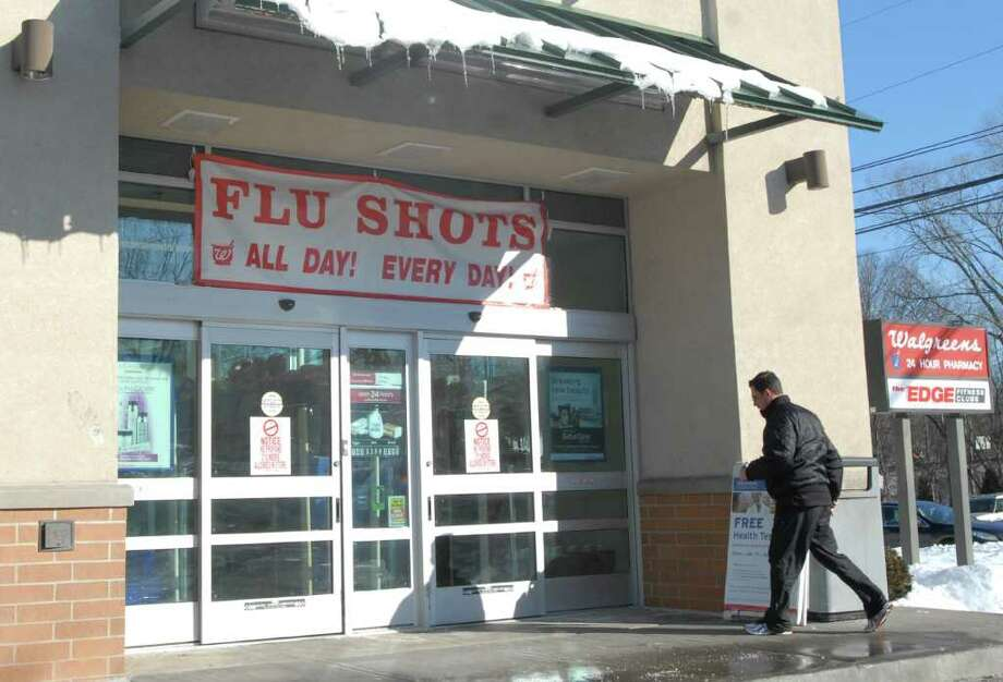 Walgreens Pharamcy in Old Greenwich has a flu shots sign hung above the entrance to their store off East Putnam Avenue, Friday afternoon, Jan. 14, 2011. Photo: Bob Luckey / Greenwich Time