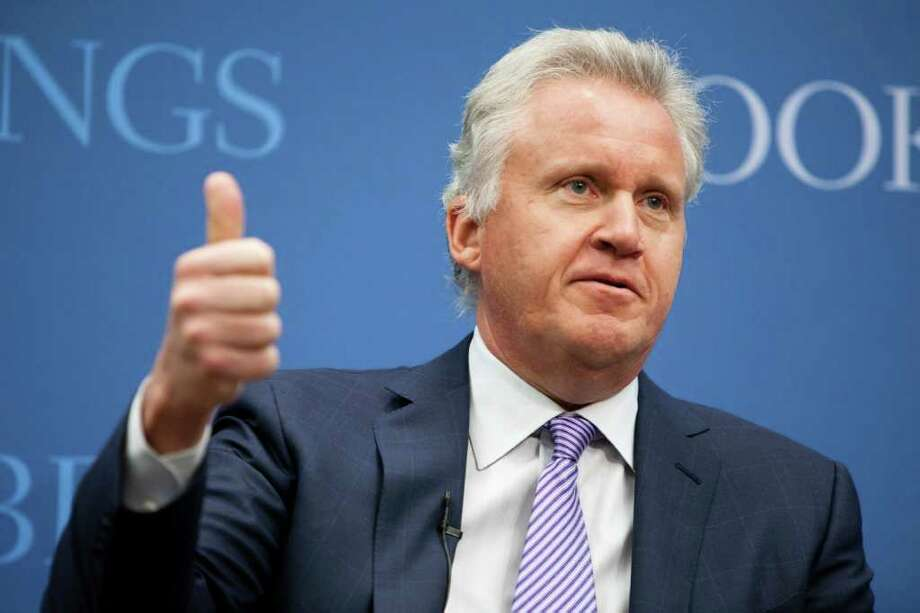 Jeffrey Immelt, chairman and chief executive officer of General Electric Co. (GE), gives the thumbs up sign during an event at the Brookings Institute in Washington, D.C., U.S., on Wednesday, Jan. 12, 2011. U.S. aviation regulators, under pressure from airlines, plan to outline by Feb. 1 how they will work with General Electric Co. and Boeing Co. to speed a transition to satellite-based navigation that may save carriers $450 million a year. The Federal Aviation Administration agreed in 2007 to let GE Aviation and Boeing's Jeppesen unit create navigation procedures available to all airlines seeking to fly more direct routes that may prevent flight diversions and save fuel. The companies so far have designed only two of the 253 satellite-based routings that exist at 74 of about 450 U.S. Photographer: Brendan Hoffman/Bloomberg *** Local Caption *** Jeffrey Immelt Photo: Brendan Hoffman, Bloomberg / © 2011 Bloomberg Finance LP