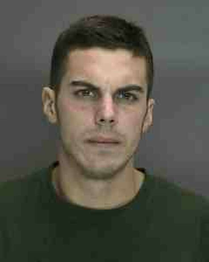 Kyle Myers, 26, is charged with two counts of first-degree robbery. (Troy police photo)