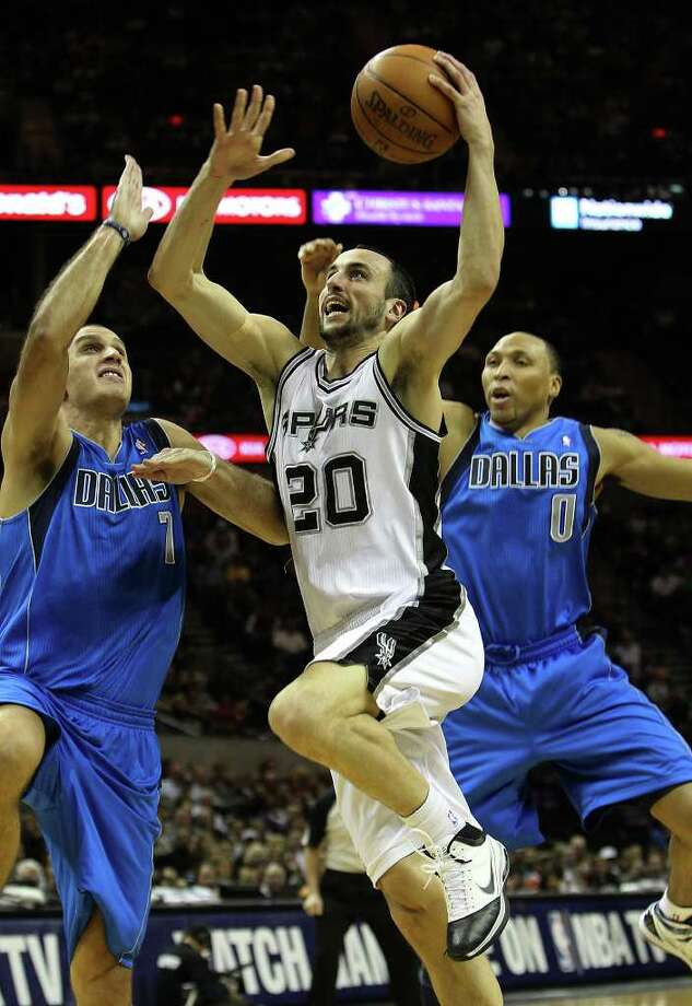Spurs' Manu Ginobili (20) drives the basket between Dallas Mavericks' Aleksandar Pavlovic (07) and Shawn Marion (0) in the first half at the AT&T Center on Friday, Jan. 14, 2011.  Kin Man Hui/kmhui@express-news.net Photo: KIN MAN HUI, SAN ANTONIO EXPRESS-NEWS / San Antonio Express-News