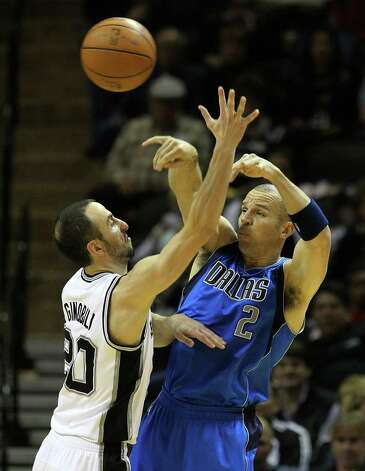 Spurs' Manu Ginobili (20) crowds Dallas Mavericks' Jason Kidd on a pass in the second half at the AT&T Center on Friday, Jan. 14, 2011. Spurs defeated the Mavericks, 101-89. Kin Man Hui/kmhui@express-news.net Photo: KIN MAN HUI, SAN ANTONIO EXPRESS-NEWS / San Antonio Express-News