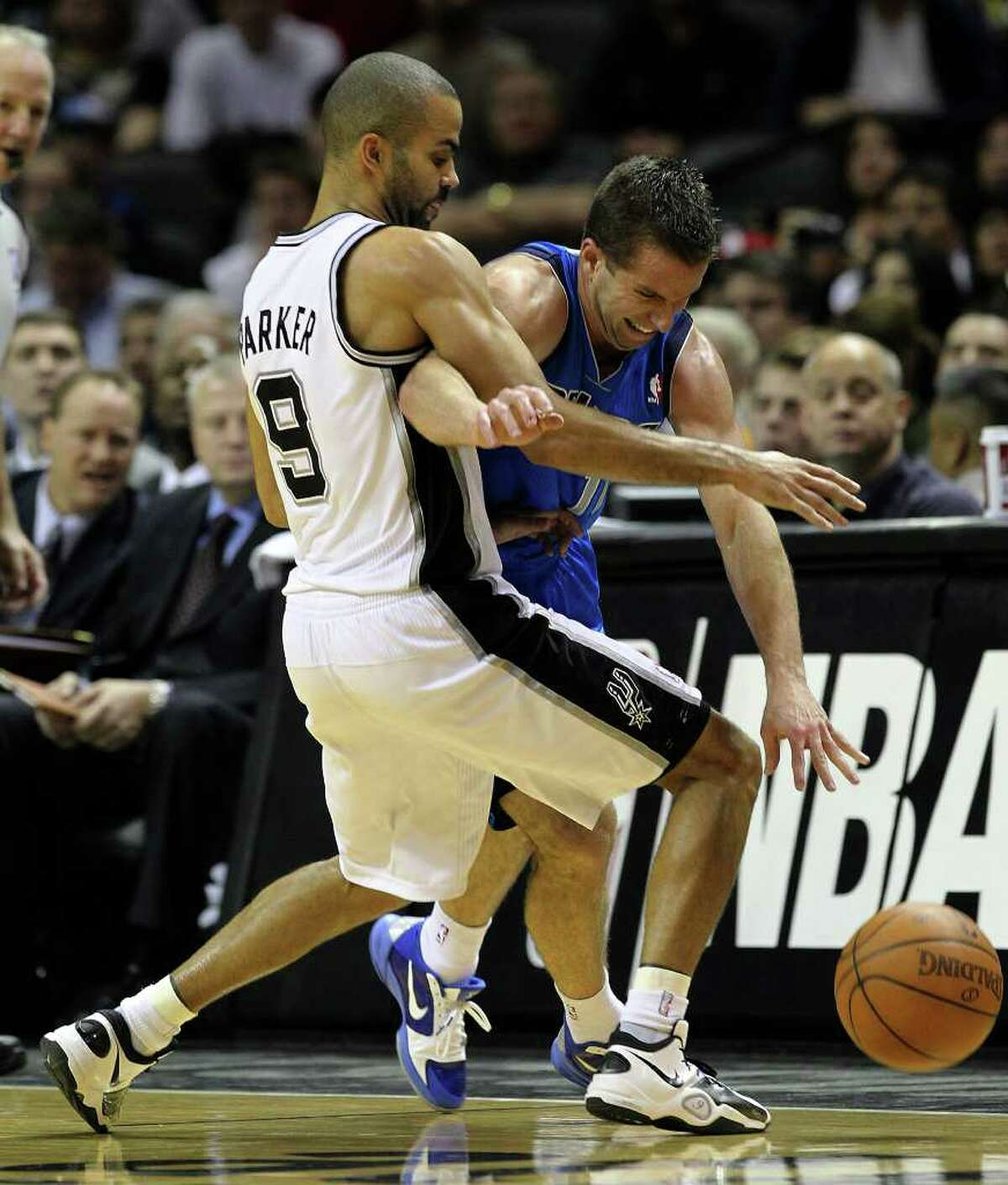 Spurs' Tony Parker (left) blocks Dallas Mavericks' Jose Barea in the second half at the AT&T Center on Friday, Jan. 14, 2011. Spurs defeated the Mavericks, 101-89. Kin Man Hui/kmhui@express-news.net
