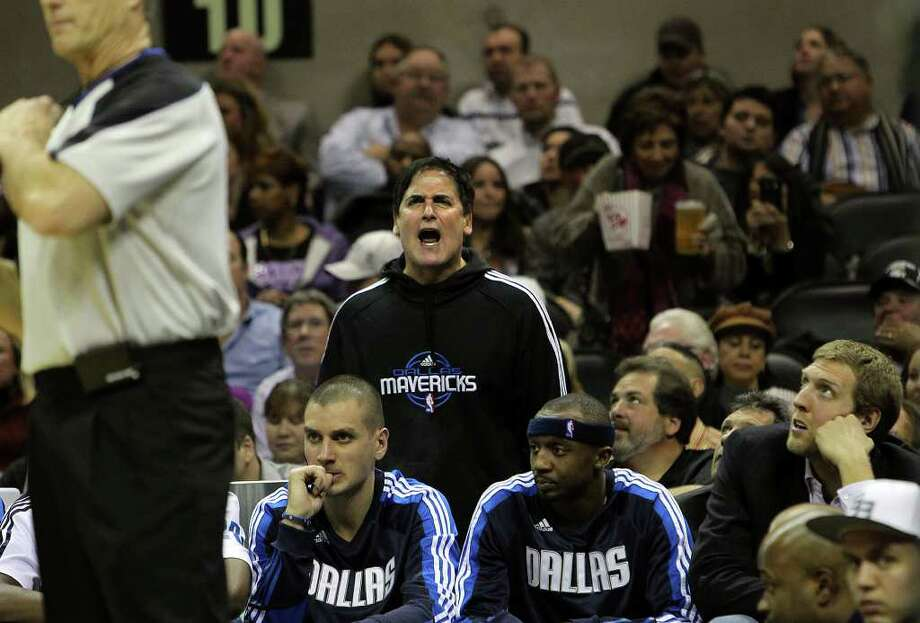 Dallas Mavericks owner Mark Cuban yells at a game official in the second half at the AT&T Center on Friday, Jan. 14, 2011. Spurs defeated the Mavericks, 101-89. Kin Man Hui/kmhui@express-news.net Photo: KIN MAN HUI, SAN ANTONIO EXPRESS-NEWS / San Antonio Express-News