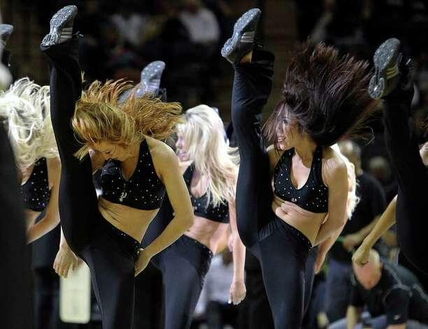 Spurs' SilverDancers high kick during a timeout performance in a game against the Dallas Mavericks at the AT&T Center on Friday, Jan. 14, 2011. Spurs defeated the Mavericks, 101-89. Kin Man Hui/kmhui@express-news.net Photo: KIN MAN HUI, SAN ANTONIO EXPRESS-NEWS / San Antonio Express-News