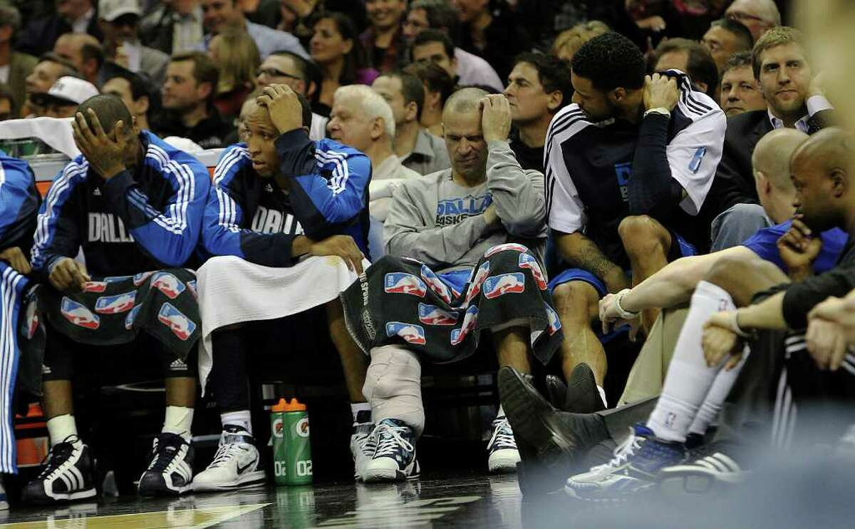 The Dallas Mavericks bench appears solemn in the second half of the game against the Spurs in the second half at the AT&T Center on Friday, Jan. 14, 2011. Spurs defeated the Mavericks, 101-89. Kin Man Hui/kmhui@express-news.net