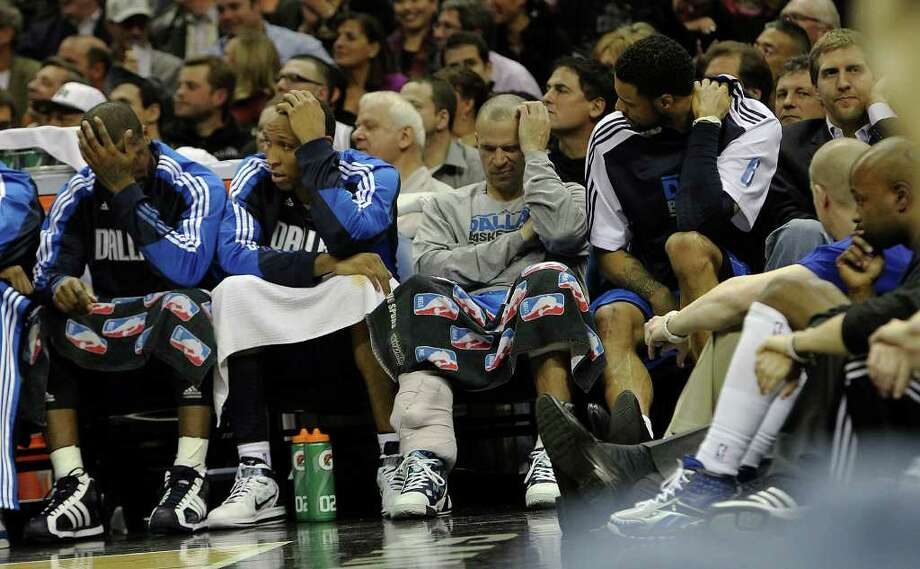 The Dallas Mavericks bench appears solemn in the second half of the game against the Spurs in the second half at the AT&T Center on Friday, Jan. 14, 2011. Spurs defeated the Mavericks, 101-89. Kin Man Hui/kmhui@express-news.net Photo: KIN MAN HUI, SAN ANTONIO EXPRESS-NEWS / San Antonio Express-News