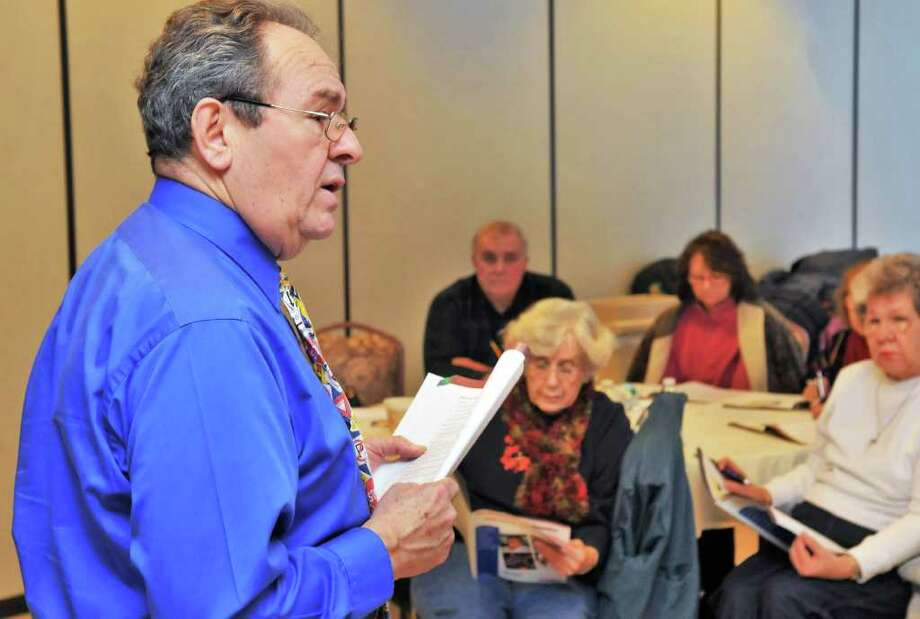 AARP Driver Safety Program instructor Ed Neary conducts a class for drivers 50 and older to help them to adjust to driving as they age at the Beltrone Senior Center in Colonie Friday morning Jan. 14.  (John Carl D'Annibale / Times Union) Photo: John Carl D'Annibale / 00011682A