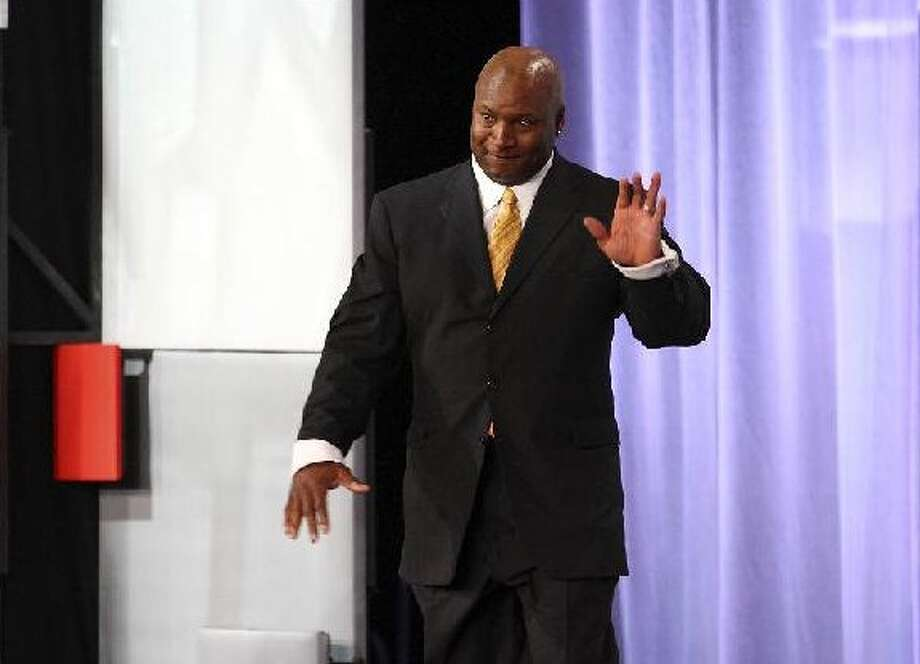 Bo Jackson, the 1985 Heisman trophy winner, takes the stage to receive a Silver Anniversary Award from the NCAA on Friday at the Grand Hyatt. The former Auburn star watched his Tigers win a national championship earlier in the week. Photo: EDWARD A. ORNELAS/eaornelas@express-news.net