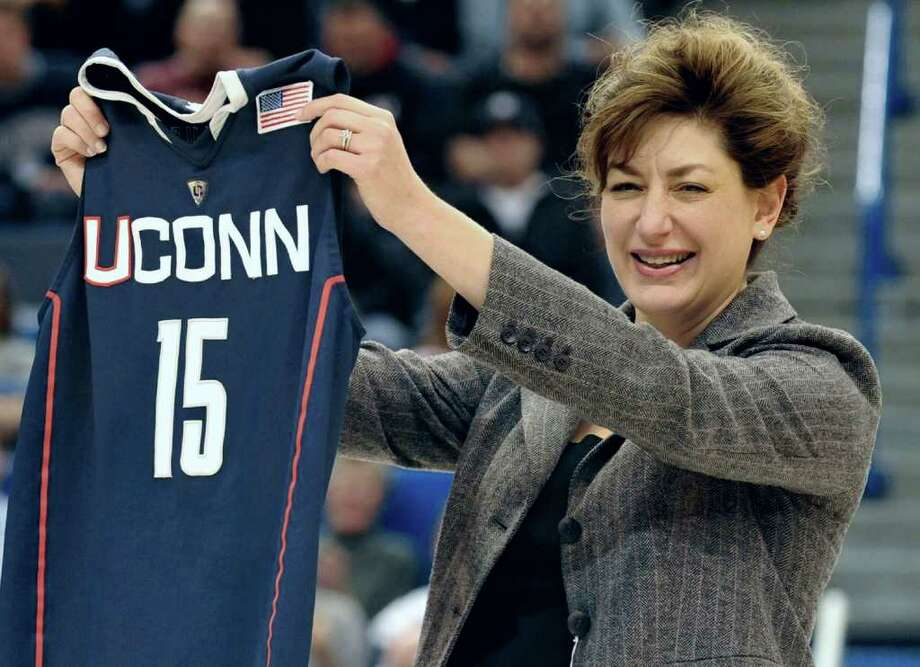 Susan Herbst, newly named 15th president of the University of Connecticut holds up a Connecticut jersey during an NCAA basketball game in Hartford, Conn., Monday, Dec. 20, 2010.  (AP Photo/Jessica Hill) Photo: Jessica Hill, ST / AP2010