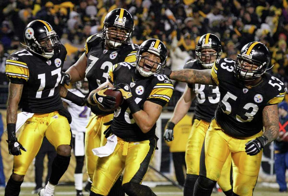 Pittsburgh Steelers wide receiver Hines Ward (86) celebrates with teammates after scoring a touchdown against the Baltimore Ravens during the second half of an NFL divisional football game in Pittsburgh, Saturday, Jan. 15, 2011. The Steelers own 31-24. (AP Photo/Gene J. Puskar)