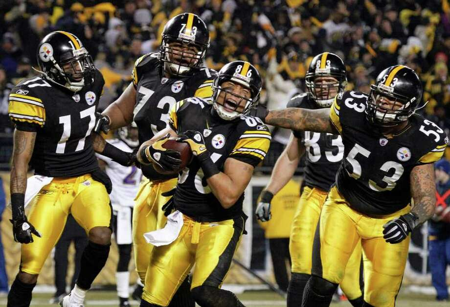 Pittsburgh Steelers wide receiver Hines Ward (86) celebrates with teammates after scoring a touchdown against the Baltimore Ravens during the second half of an NFL divisional football game in Pittsburgh, Saturday, Jan. 15, 2011. The Steelers own 31-24. (AP Photo/Gene J. Puskar) Photo: AP