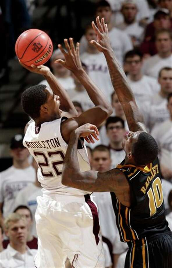 Texas A&M's Khris Middleton (22) shoots as Missouri's Ricardo Ratliffe (10) defends during the second half on Saturday in College Station. Texas A&M beat Missouri 91-89 in overtime. Photo: David J. Phillip/Associated Press