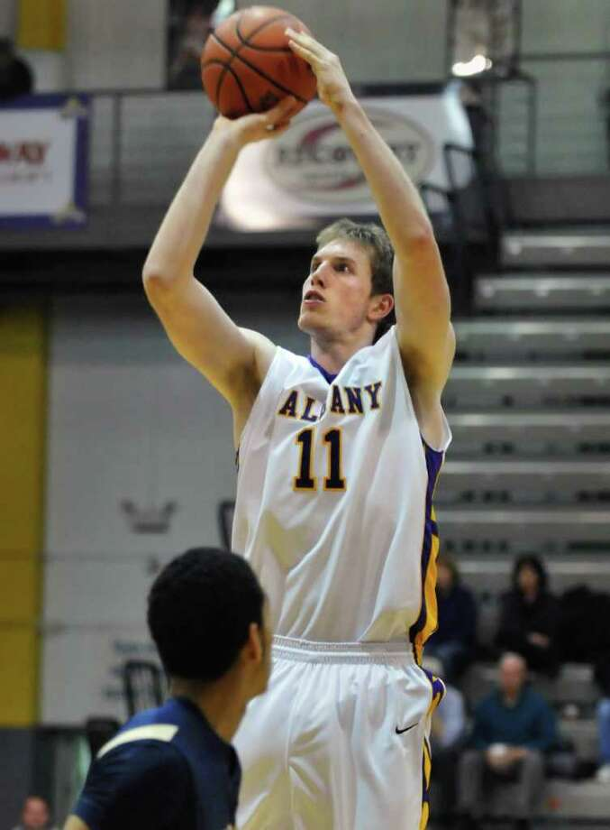University at Albany's #11, Luke Devlin, is the sole Australian on a local college men's basketball team. Here he gets off a shot against Mount St. Marys at SEFCU Arena Dec. 18, 2010.  (John Carl D'Annibale / Times Union) Photo: John Carl D'Annibale / 00011476A