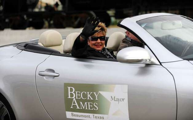 Mayor Becky Ames waves to the crowd during the Martin Luther King, Jr. Day Parade in Beaumont, Saturday. Tammy McKinley/The Enterprise Photo: TAMMY MCKINLEY / Beaumont