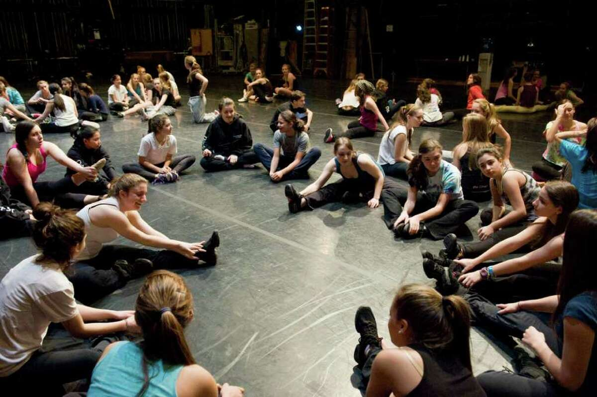 Dancers stretch preparing for Jermaine Browne's DanceFest 2011 master class in hip hop at the Palace Theater in Stamford, Conn., Sunday, January 16, 2011. The Connecticut Commission on Culture and Tourism sponsors the event which allows dance students to hone key dance techniques taught by master dance teachers like Browne.