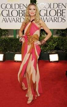 BEVERLY HILLS, CA - JANUARY 16:  Actress Heidi Klum arrives at the 68th Annual Golden Globe Awards held at The Beverly Hilton hotel on January 16, 2011 in Beverly Hills, California.  (Photo by Jason Merritt/Getty Images) *** Local Caption *** Heidi Klum Photo: Jason Merritt, Getty Images / 2011 Getty Images