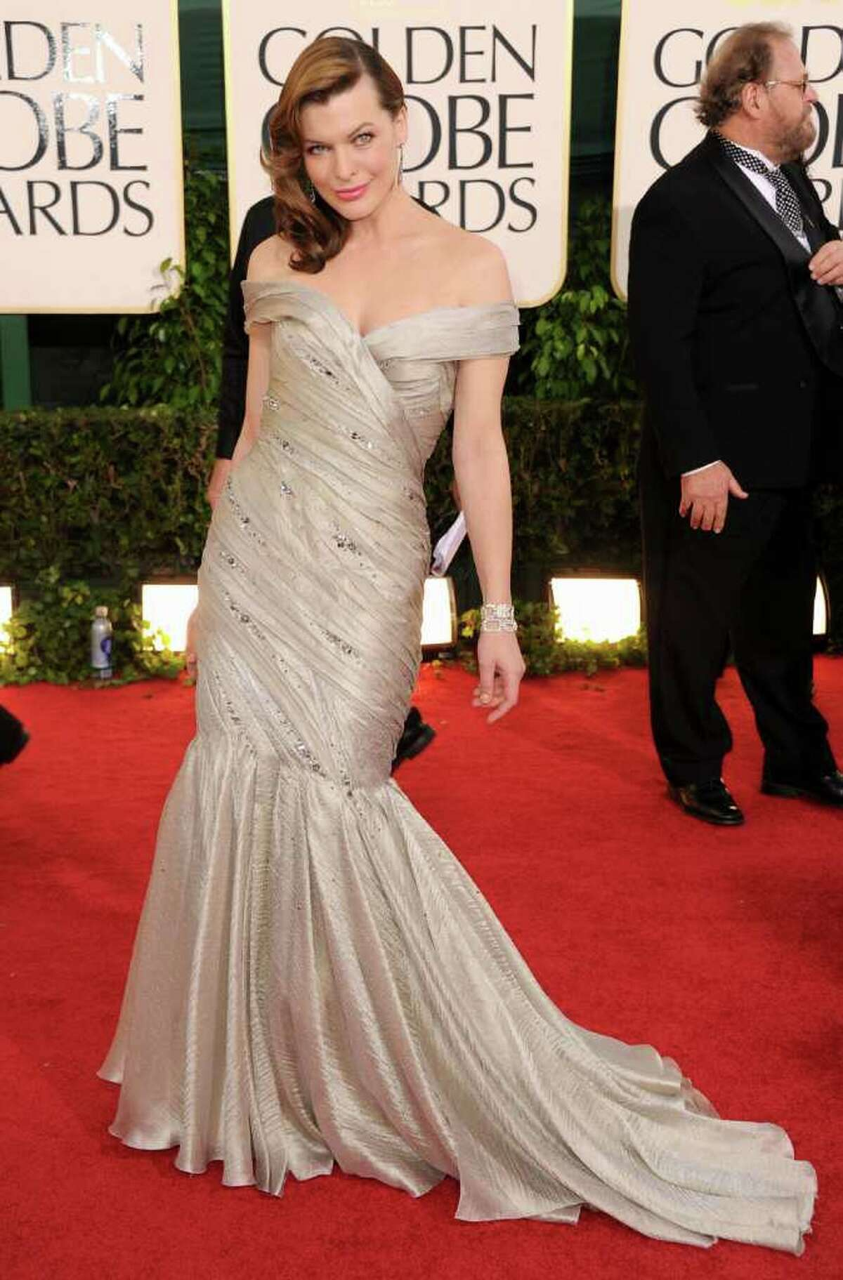 BEVERLY HILLS, CA - JANUARY 16: Actress Milla Jovovich arrives at the 68th Annual Golden Globe Awards held at The Beverly Hilton hotel on January 16, 2011 in Beverly Hills, California. (Photo by Frazer Harrison/Getty Images) *** Local Caption *** Milla Jovovich