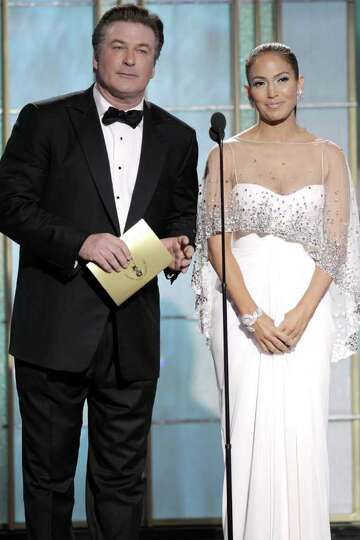BEVERLY HILLS, CA - JANUARY 16: In this handout photo provided by NBC, Presenters Alec Baldwin and J