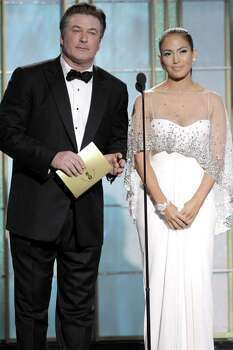 BEVERLY HILLS, CA - JANUARY 16: In this handout photo provided by NBC, Presenters Alec Baldwin and Jennifer Lopez speak onstage during the Golden Globes at the Beverly Hilton International Ballroom on January 16, 2011 in Beverly Hills, California. (Photo by Paul Drinkwater/NBC via Getty Images) Photo: Handout, Getty Images / Getty Images