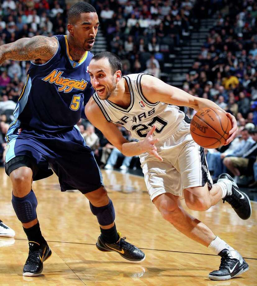 FOR SPORTS - Spurs' Manu Ginobili drives around Nuggets' J.R. Smith during first half action Sunday Jan. 16, 2011 at the AT&T Center. Photo: EDWARD A. ORNELAS, SAN ANTONIO EXPRESS-NEWS / eaornelas@express-news.net