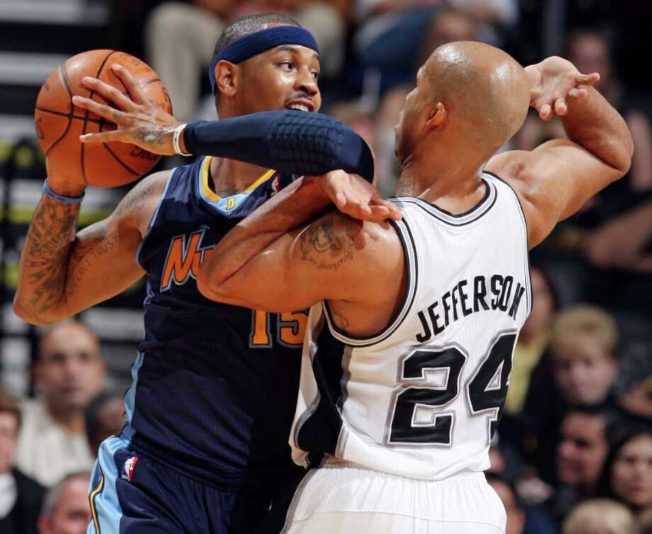 FOR SPORTS - Nuggets' Carmelo Anthony  looks for room around Spurs' Richard Jefferson during first half action Sunday Jan. 16, 2011 at the AT&T Center. Photo: EDWARD A. ORNELAS, SAN ANTONIO EXPRESS-NEWS / eaornelas@express-news.net