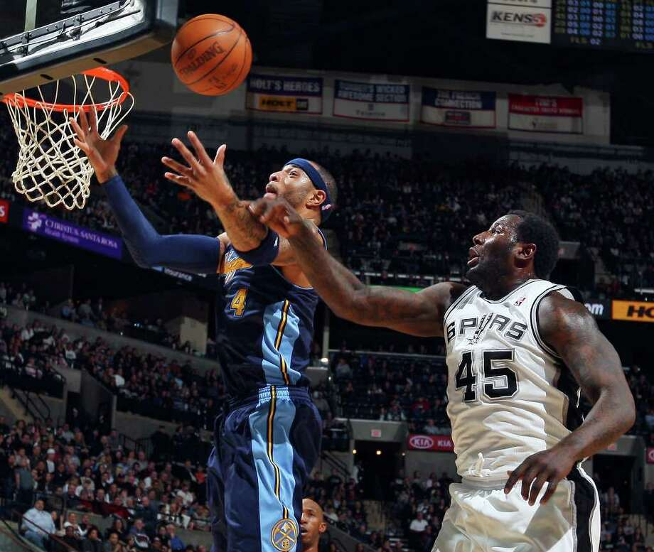 FOR SPORTS - Nuggets' Kenyon Martin and Spurs' DeJuan Blair grab for a rebound during first half action Sunday Jan. 16, 2011 at the AT&T Center. Photo: EDWARD A. ORNELAS, SAN ANTONIO EXPRESS-NEWS / eaornelas@express-news.net