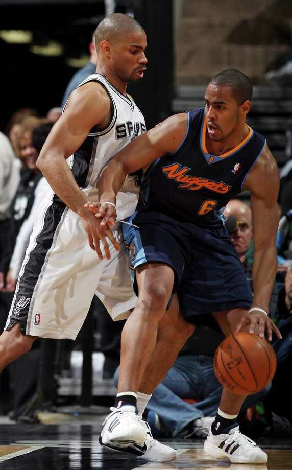 FOR SPORTS - Spurs' Gary Neal defends Nuggets' Arron Afflalo during second half action Sunday Jan. 16, 2011 at the AT&T Center. The Spurs won 110-97. Photo: EDWARD A. ORNELAS, SAN ANTONIO EXPRESS-NEWS / eaornelas@express-news.net