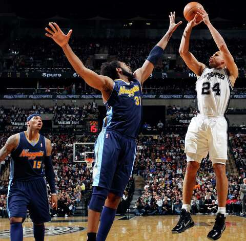 FOR SPORTS - Spurs' Richard Jefferson shoots over Nuggets' Nene as Nuggets' Carmelo Anthony (left) looks on during second half action Sunday Jan. 16, 2011 at the AT&T Center. The Spurs won 110-97. Photo: EDWARD A. ORNELAS, SAN ANTONIO EXPRESS-NEWS / eaornelas@express-news.net