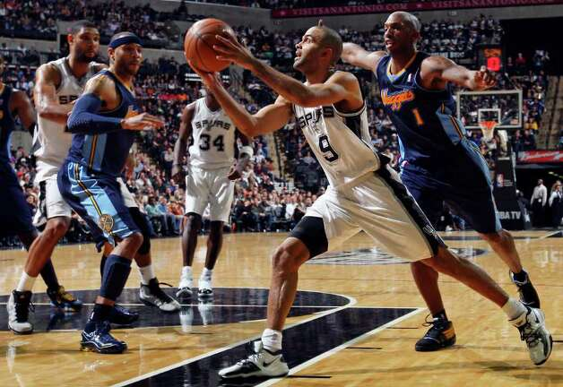 FOR SPORTS - Spurs' Tony Parker drives to the basket around Nuggets' Chauncey Billups during second half action Sunday Jan. 16, 2011 at the AT&T Center. The Spurs won 110-97. Photo: EDWARD A. ORNELAS, SAN ANTONIO EXPRESS-NEWS / eaornelas@express-news.net