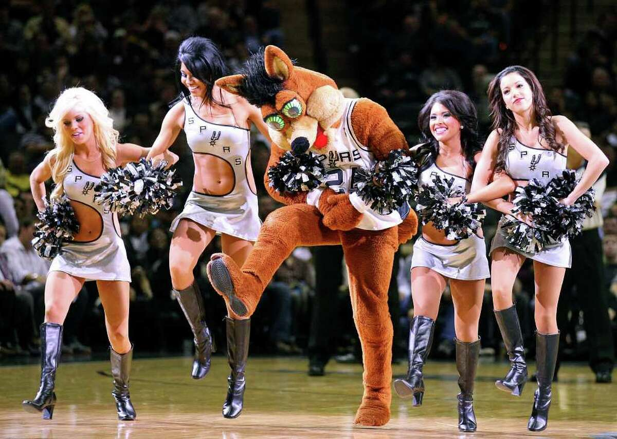 FOR SPORTS - The Spurs Coyote and members of the Silver Dancers perform during a timeout in the second half during the game with the Nuggets Sunday Jan. 16, 2011 at the AT&T Center. The Spurs won 110-97.
