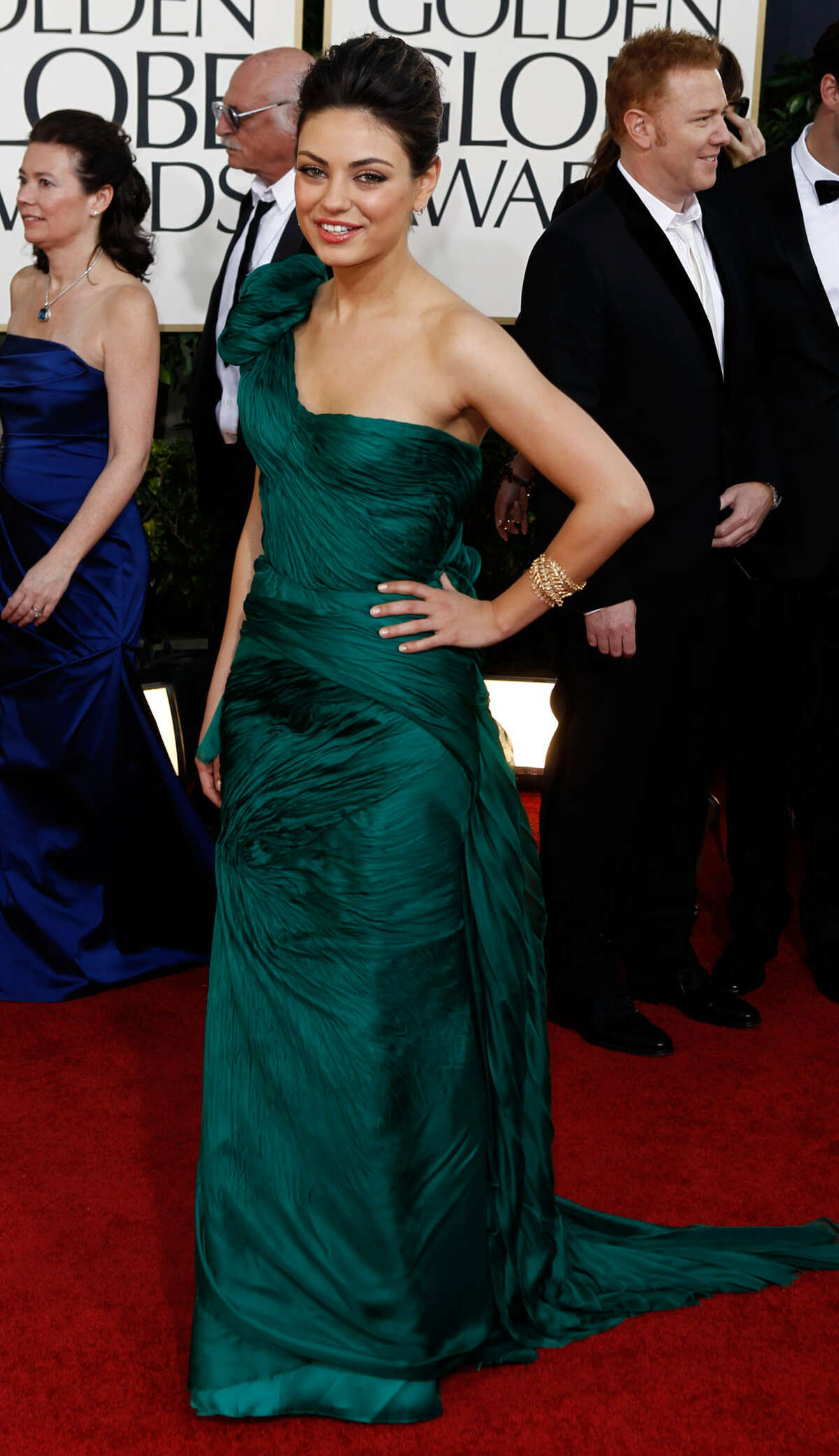 GOING 'HOME ALONE': Sans a Golden Globe - and recent ex-boyfriend Macaulay Culkin - Mila Kunis still managed to turn heads with her green-with-envy dynamite emerald green Vera Wang gown. It was heavily ruched. - Michael Quintanilla MATT SAYLES / ASSOCIATED PRESS