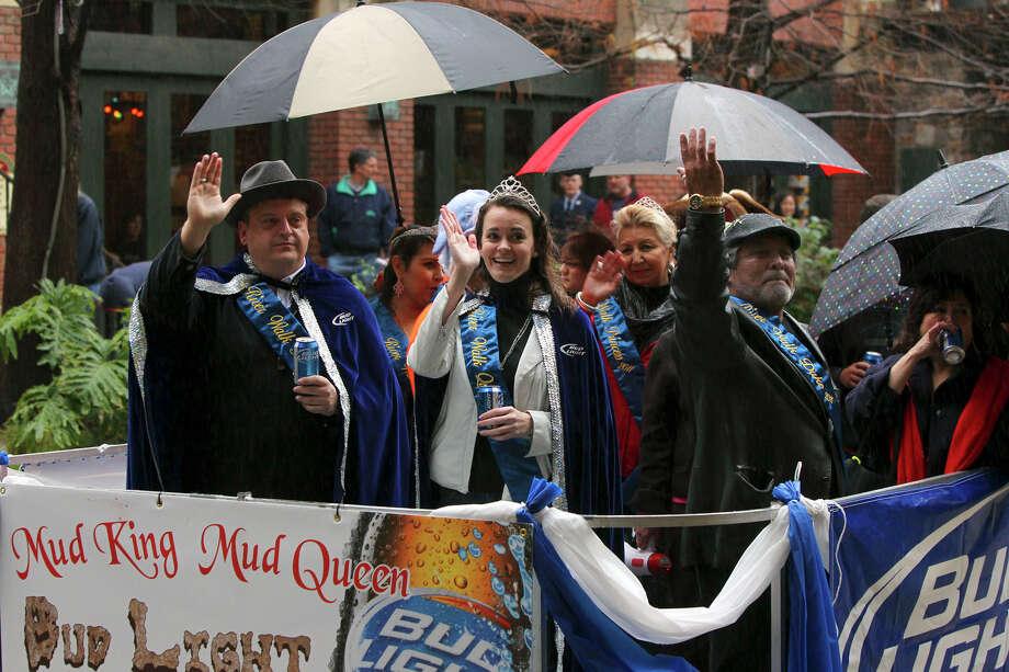 Mud King Justin Holley (left) and Queen Shanon Wasielewski greet fans. Photo: JOHN DAVENPORT/jdavenport@express-news.net