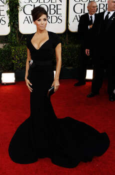 TEXT THIS TONY: Eva Longoria's plunging black stretch wool gown with laser cut detailing was designed by Zac Posen and proved that looking good as a soon-to-be divorcee, is the best revenge. — Michael Quintanilla