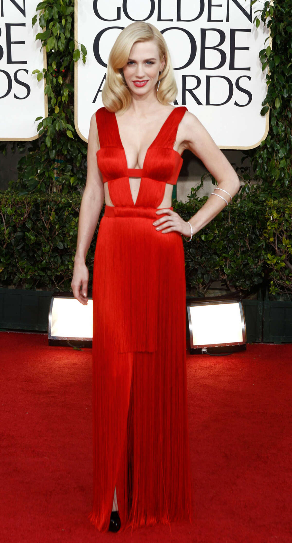 RED ALERT: January Jones, always daring on the red carped, rocked the most revealing gown of the night: a red fringed gown by Atelier Versace. Her Grace Kelly hair and red lips were perfection. - Michael Quintanilla MATT SAYLES / ASSOCIATED PRESS