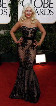 """HELLO DOILEY: Christina Aguilera looks like she's wearing a dinosaur-sized doiley. This dreadful dress is from Zuhair Murad. Unlike her Burlesque movie song """"You Haven't Seen the Last of Me,"""" we're hoping we've seen the last of this mess. — Michael Quintanilla PHOTO BY MATT SAYLES / ASSOCIATED PRESS"""