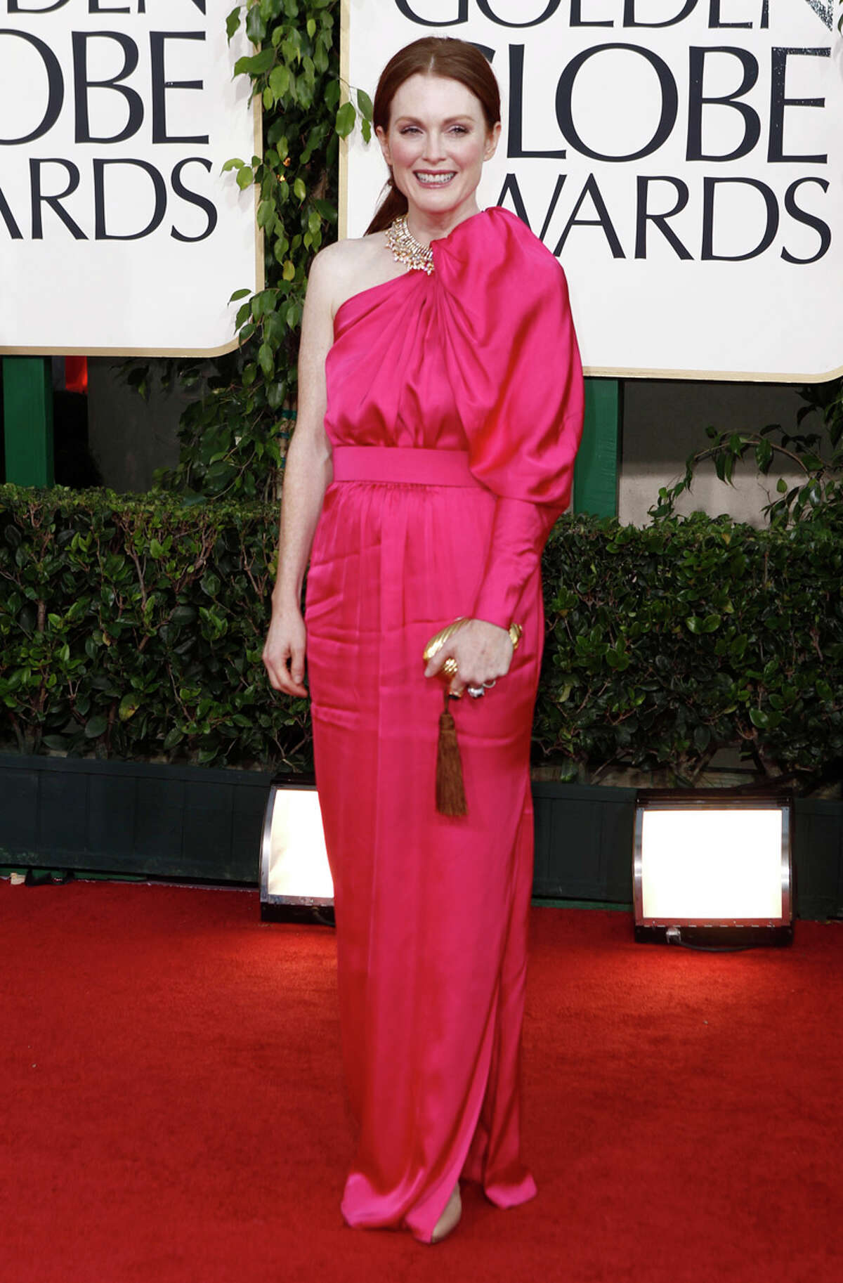 PINK STINK: Redhead Julianne Moore should have worn green (which she has) because she looks stunning in it - and it was a favorite hue at the Globes. Instead she opted for this single, poufy-sleeved disaster from Alber Elbaz at Lanvin. - Michael Quintanilla PHOTO BY MATT SAYLES / ASSOCIATED PRESS