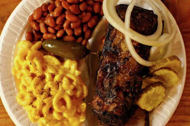 Beef ribs served with macaroni and cheese and pinto beans at Bolner's Meat Market. Photo: LISA KRANTZ, SAN ANTONIO EXPRESS-NEWS / SAN ANTONIO EXPRESS-NEWS