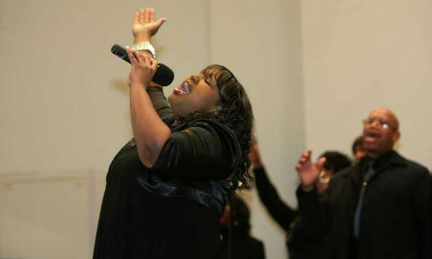Noelle Pinyard, of the East End Baptist Tabernacle Church Mass Choir, sings during the 32nd Annual Dr. Martin Luther King, Jr. celebration at Mount Avery Baptist Church in Bridgeport on Monday, Feb. 17, 2011. Photo: B.K. Angeletti / Connecticut Post