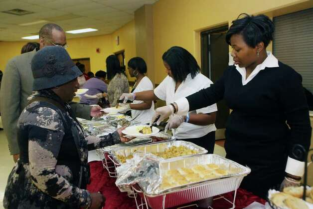 Attendees have breakfast after the 32nd Annual Dr. Martin Luther King, Jr. celebration at Mount Avery Baptist Church in Bridgeport on Monday, Feb. 17, 2011. Photo: B.K. Angeletti / Connecticut Post