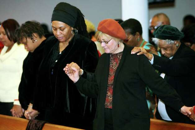 Attendees pray during the 32nd Annual Dr. Martin Luther King, Jr. celebration at Mount Avery Baptist Church in Bridgeport on Monday, Feb. 17, 2011. Photo: B.K. Angeletti / Connecticut Post