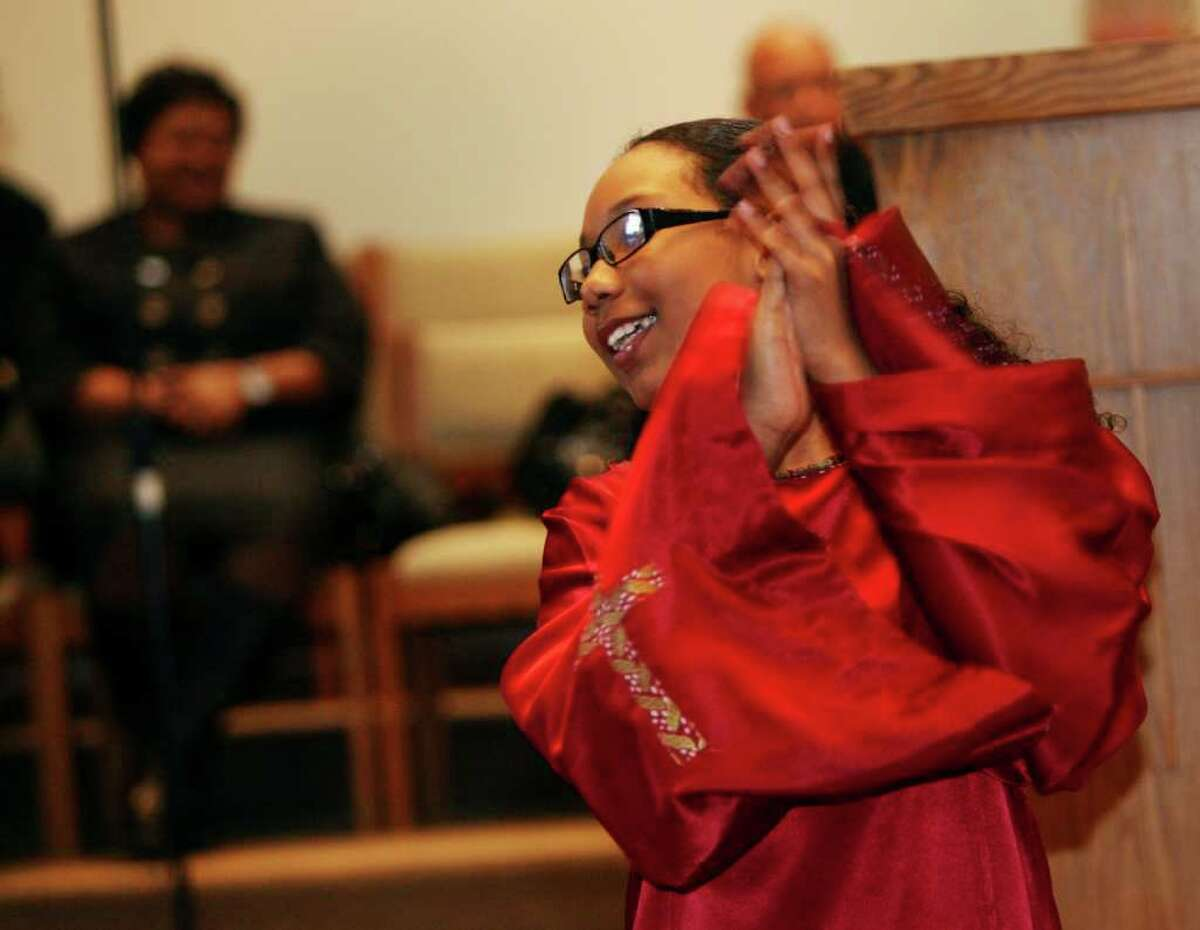 McKaela Paris-Askew, 13 of Bridgeport, performs with Sistaz of Praize during the 32nd Annual Dr. Martin Luther King, Jr. celebration at Mount Avery Baptist Church in Bridgeport on Monday, Jan. 17, 2011.