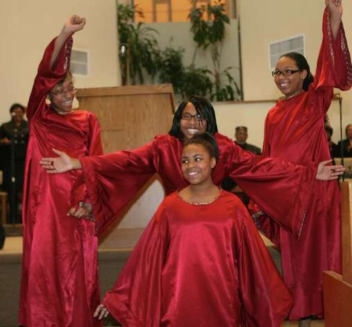 Sistaz of Praize perform during the 32nd Annual Dr. Martin Luther King, Jr. celebration at Mount Avery Baptist Church in Bridgeport on Monday, Feb. 17, 2011. Members of the dance group are, from left, Yazline Santiago, 11, Crystal Young, 15, back, Adrienne McNeil, 12, and McKaela Paris -Askew,13. Photo: B.K. Angeletti / Connecticut Post